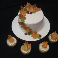 Thanksgiving Wedding Cake & Cupcakes  This was made for a small wedding two days after Thanksgiving. All from scratch - the cake is chocolate cake with vanilla bc, cupcakes are...