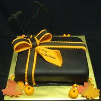 Halloween Birthday Gift  All from scratch: chocolate cake, chocolate bc, & chocolate fondant. Fondant/gumpaste bow, ribbon, bats, pumpkins & leaves. (Real...