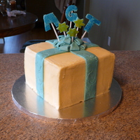 Birthday Present This was the first attempt at a birthday present cake. Decided to use SMBC instead of covering in fondant and next time I think I would...