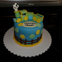 Train Baby Shower Cake Blue and white cake layers inside covered in marshmallow fondant with gumpaste train and buttons.