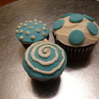 Blue And White Fondant Covered Cupcakes This order was for monochrome cupcakes - the customer didn't want all of them to match. So I took some leftover blue MMF and white BC...