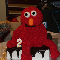 Elmo Cake  Made this cake for my sons 2nd bday. The head, arms, and legs are RKT. I did not cover them in fondant and it fell apart right before it...