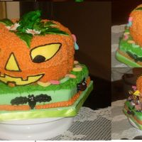 Trick Or Treat Pumpkin Cake Made with ButterCream Icing and Fondant. The cake flavor is Pumpking and Nuts. Delicious and it is an open pumpkin with candies and worms...