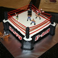Wrestling Ring Cake   pull-n-peel twizzlers for the ropes and mini wrestler figures... everything else buttercream (dowels in the corners for the posts)