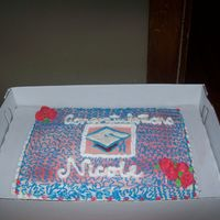 Graduation Cake Red White And Blue Theme Lemon cake with cherry filling, butter cream icing, and cap is made with color flow