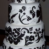 Black & White Parisian Wedding Cake First tier is a single layer, rest of the tiers are 3-layers each, flavor for all tiers is Red Velvet with Cream Cheese Filling and...