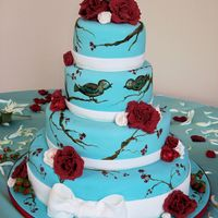 """birds & Branches"" This was a unique cake because the branches and the birds are handpainted on the cake. All the flowers, ribbon and the bow are made from..."