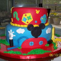 Mouse Club This was a cake we made for a childs birthday, the theme was Mickey Mouse Club. All decorations are made from fondant.