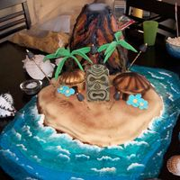 Volcano Cake This was a cake I did for a Luau Party. The Volcano was erupting smoke when we added dry ice and water. Volcano was made of cake covered...