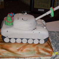 Army Tank Bringing Christmas To The Soldiers This was a cake I made Amry Unity Christmas Party, The tank was Chocolate and Yellow with Buttercream.