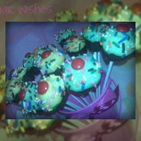 Cupcake Pops I saw Bakerella's cupcake pops and have been dying to make them!!! They are red velvet with cream cheese frosting covered in chocolate...