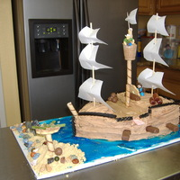 Pirate Ship My practice cake for my Daughters birthday, cake (forgot to take one of the actual cake at her party :( BC and various candies to decorate...