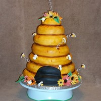 Beehive fondant cakes, 10, 9, 8, 7, 6, 5 Fondant bees and gumpaste flowers. My airbrush arrived just as I was getting ready to luster dust my...