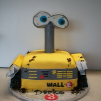 Wall E Wall E cake! a lot of fun to make... I did have trouble figuring out what to use for the eyes and eventually settled on styrofoam with a...