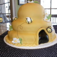 Beehive Cake Donated to local women's shelter for their volunteer's luncheon. Lemon cake tiers, carved in curved design and covered in fondant...