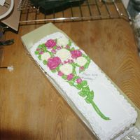 """bouqet Of Flowers"" Cake This is a sheet cake cut down, filled with strawberry icing and strawberry filling. The ""placard"" is fondant written on with an..."
