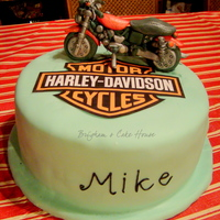 Harley Davidson Cake  It was four layer sponge cake filled with strawberry 'n cream mouse (found in cc recipes) covered with marshmallow fondant. The motor...