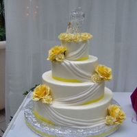 4 Tier Drapes Dummy cake from bridal show, all buttercream with fondant drapes, silk flowers.