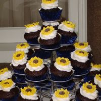 Sunflower Cupcake Tower Vegan and regular chocolate cupcakes with royal icing sunflowers on top.