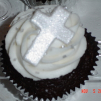Baptism Cupcake Triple chocolate cake, peanut butter buttercream filling, vanilla buttercream frosting, silver chunky sugar sprinkles, fondant cross with...