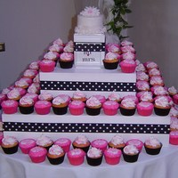 Wedding Cupcake Tower Black cupcake liners have yellow cake with vanilla buttercream frosting swirls and hot pink sugar sprinkled on top. Pink cupcake liners...
