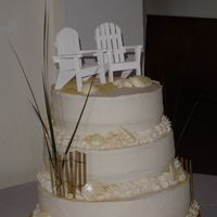Beach Themed Wedding Cake Wooden adirondack chairs for topper; french vanilla cake, lemon filling, vanilla buttercream, white chocolate shells and sand dollars with...
