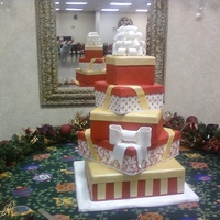 Christmas Wedding 5 Tier Christmas Presents wedding cake. My first attempt at box tops but the bride was very happy anyways.