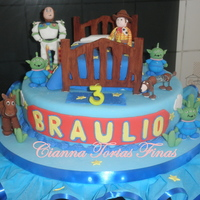Toy Story Cake   All characteres made of gum paste. Bed is a orange with chocochips cake and I used pastillaje.