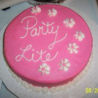 Partylite Round Cake   yellow cake, frosted with pink BC, white drop flowers with matching pink dots. Made for a PartyLite candle party I hosted.