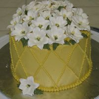 Lillies Buttercream icing with royal icing lillies.