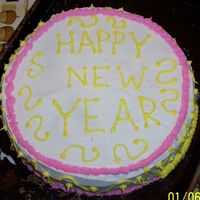 "Happy New Year!  2 9"" round cakes stacked, Marble Cake iced with Wilton's Ready-to-Use Decorator's Icing. The pink and yellow was icing that..."