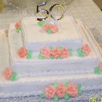 "50Th Anniversary Cake  3 tier white cake, bc icing. Peach colored roses. ""50"" cake topper pick, swan from original cake topper (from 1957), shell..."