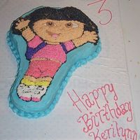 Dora Character Cake  White cake with pink coloring added, to make it a pink cake (per my daughter's request), used the Dora character pan. BC icing, star...