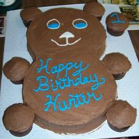 Hunter's First Birthday Cake  devils food cake. Round cake for head, round cake for body, cupcake for legs, arms and ears. Frosted with chocolate BC. Done for my son&#...