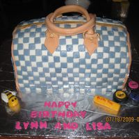 Louis Vuitton Purse Cake My first attempt on a purse cake. Red velvet with raspberry cream cheese filling with MMF details.