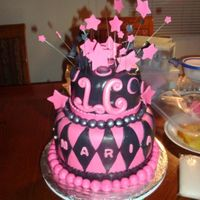 Sweet 16 Birthday Cake This was my 1st two tiered fondant birthday cake. Bottom tiered is chocolate cake with chocolate filling. Top tier is yellow cake with...