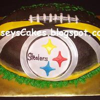 Steelers Football   3-D football cake, all chocolate with vanilla buttercream icing. Fondant accents & buttercream details. All airbrushed