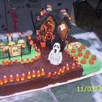 Ginger's Halloween Cake 2007 My daughter, Theresa and I had fun making the haunted house together then we used it to top the cake for Ginger's Party. Candy accents...