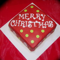 Family Christmas Cake buttercream with satin ice fondant accents