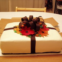 Birthday Cake ~ Man Made this cake for an older gentleman with a late October birthday. Icing is buttercream, bow is chocolate Satin Ice fondant, flowers are...