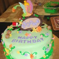 Tinkerbell All fondant accents. The tinkerbell was a cake topper- was too afraid to attempt that in fondant.