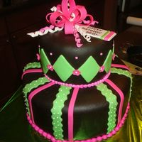 Pink And Green Cake This was for a 13 year old girl. The bow, stripes and diamonds are all fondant. It's chocolate cake, chocolate ganach and chocolate...