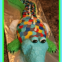 Rainbow Alligator 30 inches long! Vanilla and chocolate with fondant scales and BC on the sides.