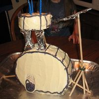 Drum Cake this was my little girls fourth birthday cake. i was rushed and i should have used buttercream icinging instead of betty crocker but it...