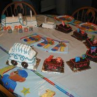 Train Cake my sons first birth day cake. i saw a picture in a book and gave it a try the one in the book was alot nicer i was please it was my first...