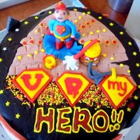 U R My Hero A cake for a friend's father who is working in the cleaning industry...a superman cake but a version of her father...short, bald and...