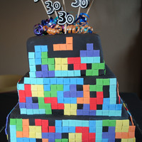 Tetris Cake Top 2 layers are Champagne Cake with Strawberry Filling the bottom layer is Chocolate Chambord Cake with Raspberry Filling. This cake took...