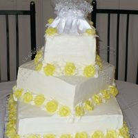 Square Wedding Cake With Yellow Roses Three teir lemon cake with lemon filling. Yellow buttercream roses.