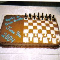 Chess Board Cake This is a groom's cake that I had made for some friends, along with their wedding cake (which was my first). It was kind of hard at...