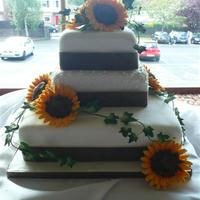 Sunflower Wedding Cake my second square wedding cake with 3 inch high tiers. sugar sunflowers and piping detail on middle tier. i bought the sugar ivy - just cant...